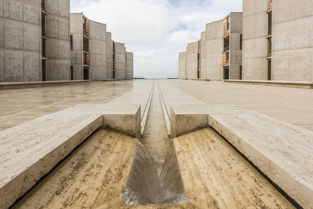 With the addition of rebar, modern architects were able to  make concrete strong enough to build up in several stories high and durable enough to last. The Salk Institute is a showcase of modern architecture that features concrete in the raw.