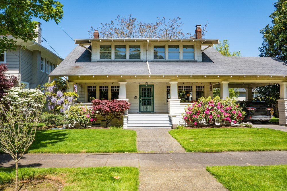 Portland Mid Century Modern home is actually a Craftsman, a style popular during the 1940s. Still, it features wide windows and overhanging eaves modernists used.