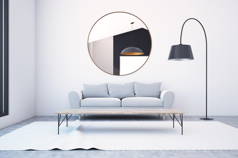 The sweep of this lamp leads the eye. The large lampshade, lined with reflective silver material, ensures abundant light, maximizing its functionality.