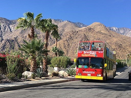Palm Springs Mid Century Modernism Week features fun double-decker buses for tours of the homes. Photo courtesy of Abbe Rose
